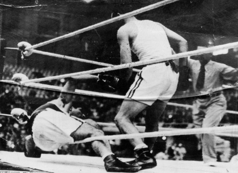 StateLibQld_1_175511_Boxer,_Adrian_Holmes,_knocks_an_opponent_to_the_mat_in_the_London_Olympics,_1948