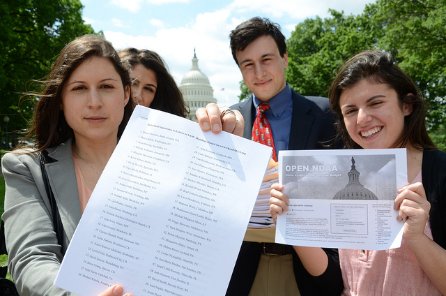 POGO staffers delivering thousands of signatures to the hill